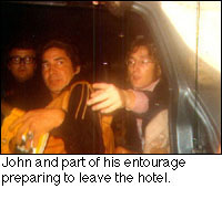 John and his entourage preparing to leave the hotel.
